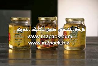 صورة توضح شرينك عبوات عسل النحل مقدمة من شركة المهندس منسي لتغليف الحديث و الصناعات الهندسية M2Pack.com